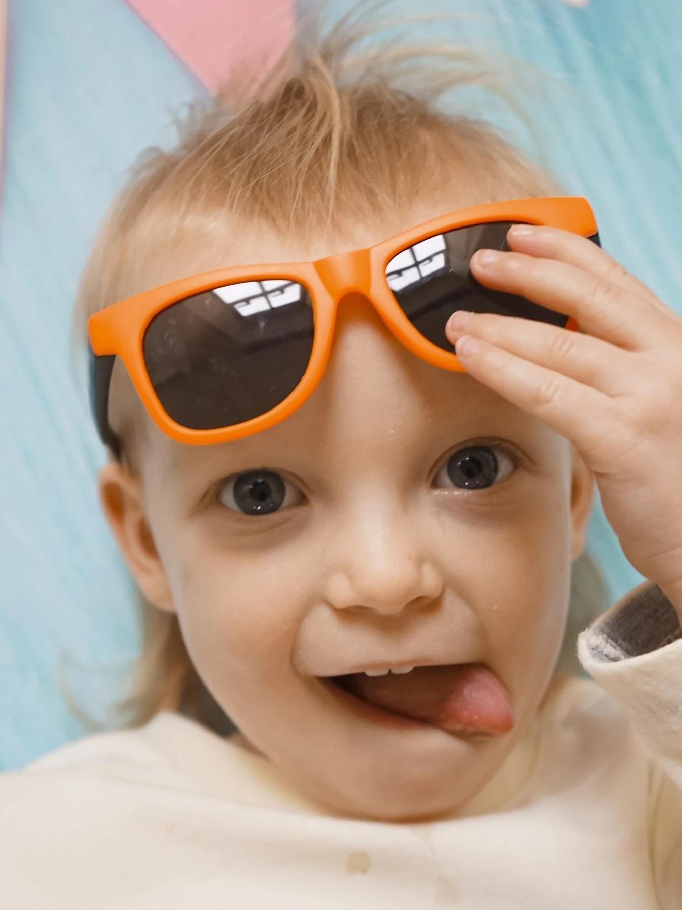 orange_and_black_sunglasses_4240de54-4ae3-4235-b48a-c7ff48126f17_1800x1800